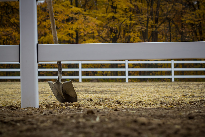 Shovel Leaning on Horse Fence