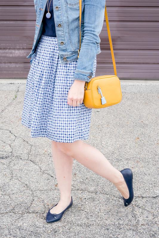 j.crew gingham skirt + navy tee + denim jacket + yellow crossbody purse + navy ballet flats + J.Crew tortoise sunglasses; spring casual outfit | Style On Target blog