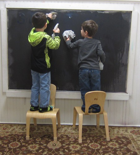cleaning the chalk board