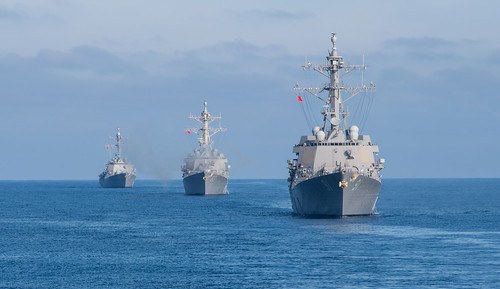 The guided-missile destroyers USS Pinckney (DDG 91), USS Howard (DDG 83) and USS Shoup (DDG 86) steam in formation behind the guided-missile cruiser USS Princeton (CG 59) during a life-fire exercise