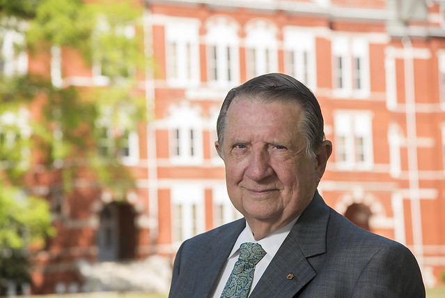 Jim Odom stands in front of Samford Hall at Auburn University.