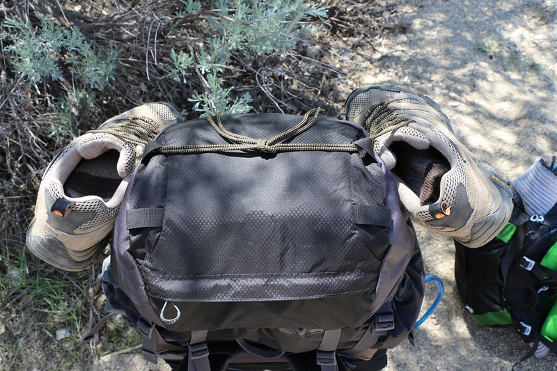 I take off my shoes and tie them to the top of my pack prior to crossing the creek