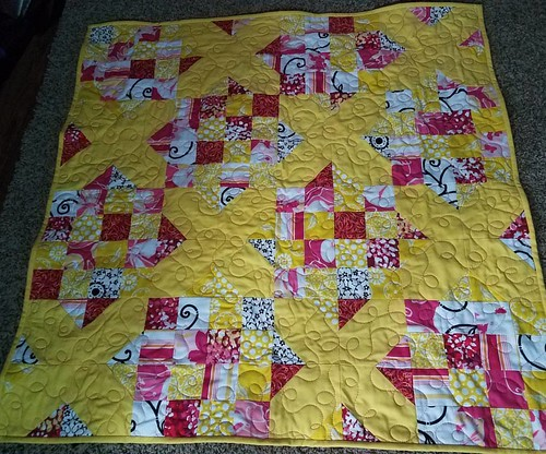 A quick finish tonight after I uncovered the sewing machine. Everything is back in the closet that is going back in there. Goodnight Irene using yellow, black, white, and pink scraps. Baby playmat quilt size.
