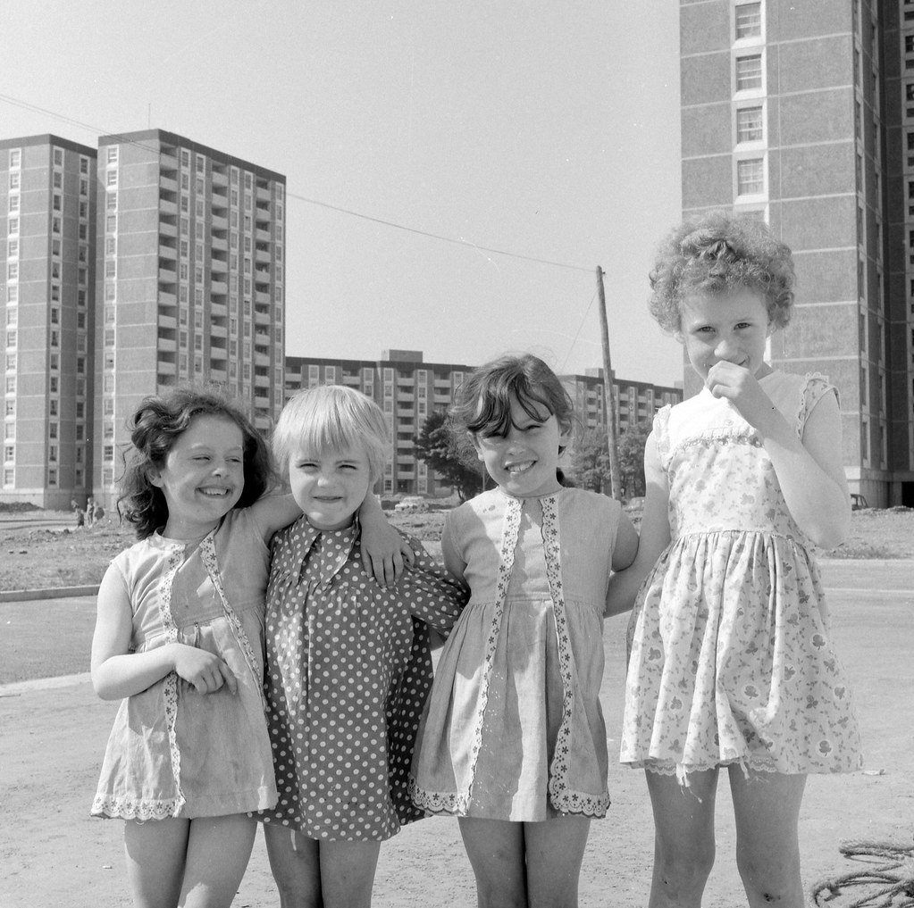There's always one!  Four little girls in the shadow of the Ballymun tower blocks. | by National Library of Ireland on The Commons