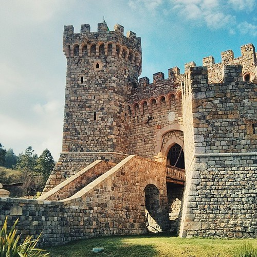 The entrance to the castle. Looks very fairy-taleish! I was, yet again, impressed and enamored  #castle #tower #napa #castellodiamorosa #vineyard #winery #tuscan #castello #winecountry #entrance #rocks #bridge #sky #clouds #sun #trees #napavalley #perspec | by a25i