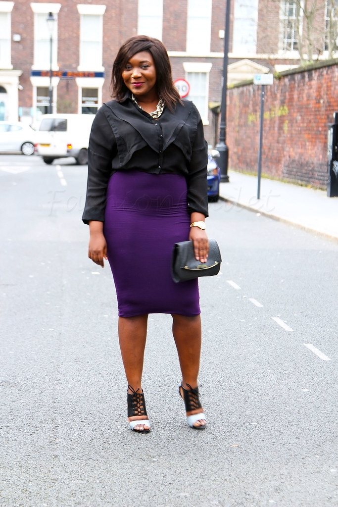 purple-midi-length-pencil-skirt-black-top-chunky-necklace-black-top,pencil skirts below the knee,  pencil skirt, high waisted pencil skirt, purple tube skirt, pencil skirt short, midi length pencil skirt, plus size fashion, how to dress a curvy body, plus size fashion, how to style a plus size, bodycon midi skirt, pencil skirt outfits, black ruffle top, ruffle top, black ruffle blouse, ruffle blouse, Purple stretchy high waisted pencil skirt with a black ruffle top, chunky chain & peep toe heeled ankle booties