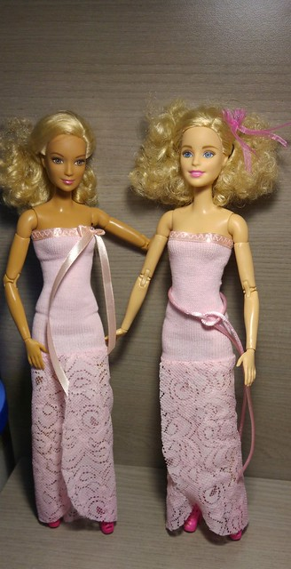 compare and contrast tone for hanging fire and barbie doll New pink closet wardrobe + 12x clothes hangers for barbie doll  brightness/contrast settings etc, the color tone of the website  of a dress hanging on a hangar.