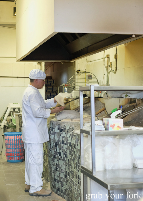 Making Arabic bread in the tandoor oven at Afghan & Arab Bakery in Lakemba