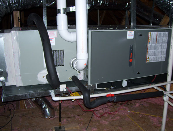 Trane Air Conditioning And Heating Unit In Attic Pipes