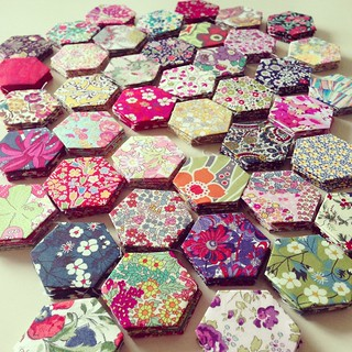 "252 basted 1"" hexies and many more to go! 