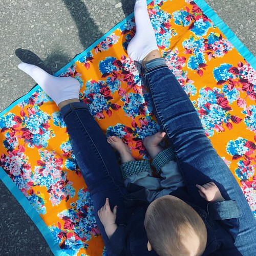 Family time in the sunshine. The picnic blanket is from my first book. #blessed #bakeknitsew #motherhood #feet #baby #mayday2017 #legs #birdseyeview #motherhood