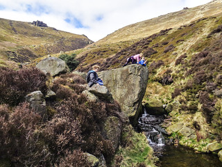 Kids posing on Crowden Clough rock