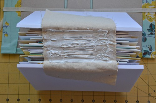 29. Spread out glue on binding canvas.