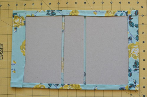 26. Glue the sides of the book cloth to the book boards.