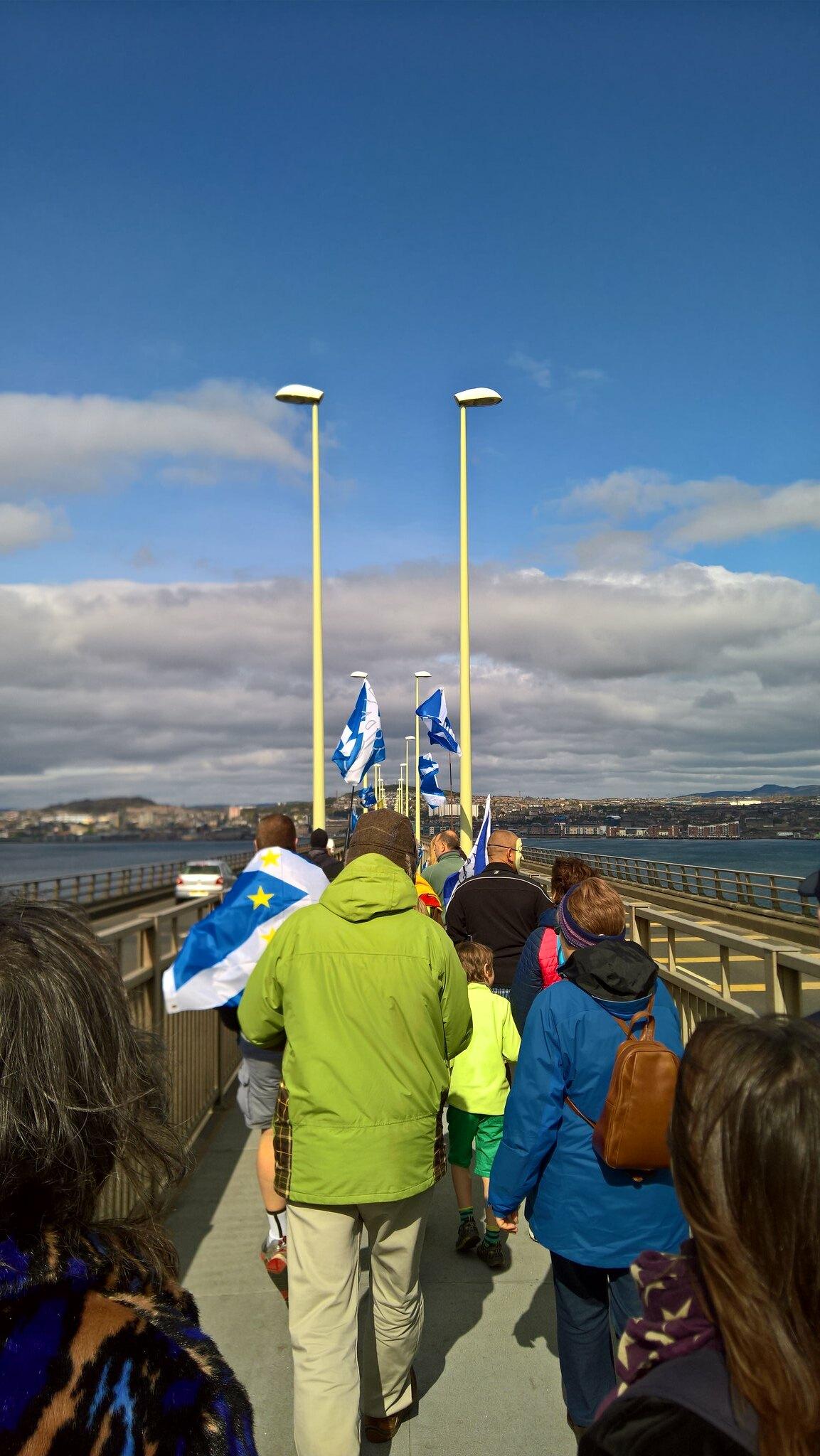 People marching across the Tay Bridge