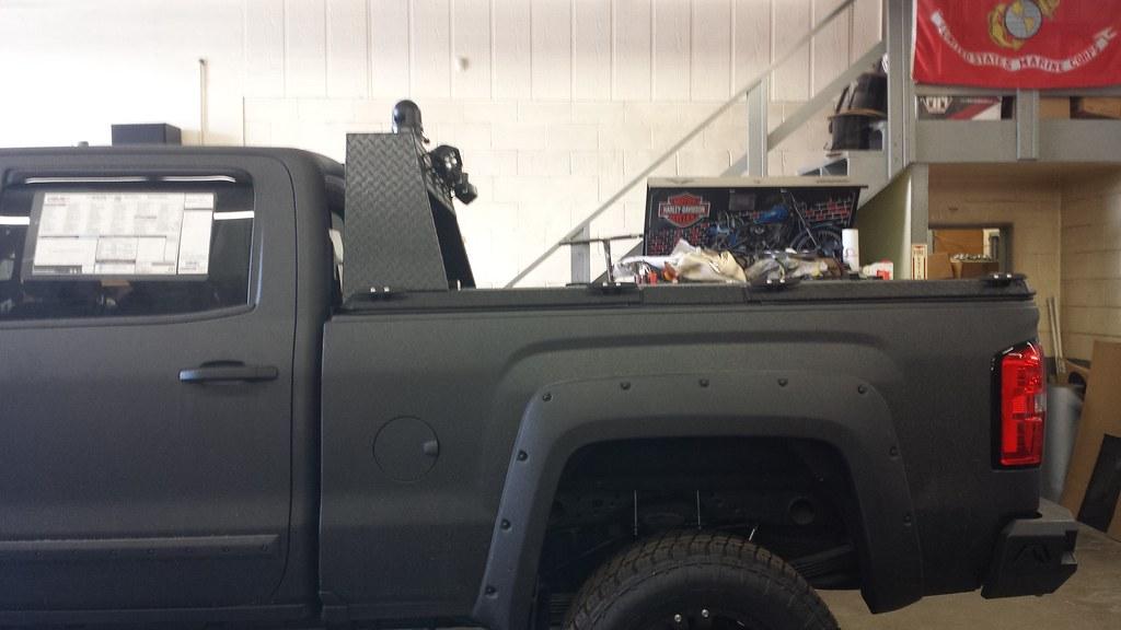 A Heavy Duty Cover With Custom Headache Rack On A Chevy/GM ...