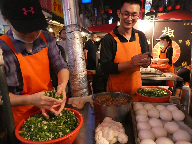 Preparing Black Pepper Pork Buns at Raohe Night Market, Taipei