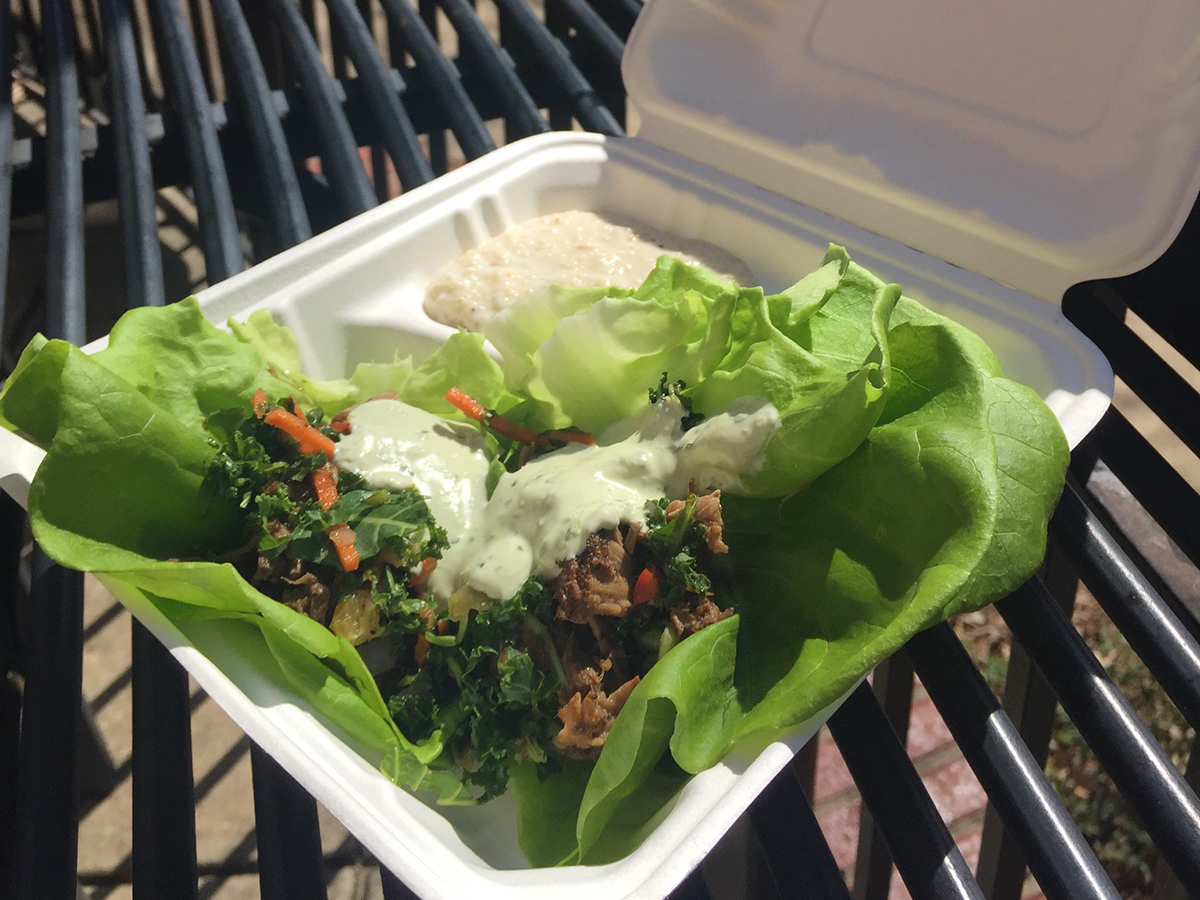 A plate of salad on an outdoor table.