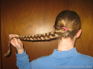 Pull the braid to the side to begin the Braided Bun - 12 Hiking Hairstyles that are Pretty & Practical