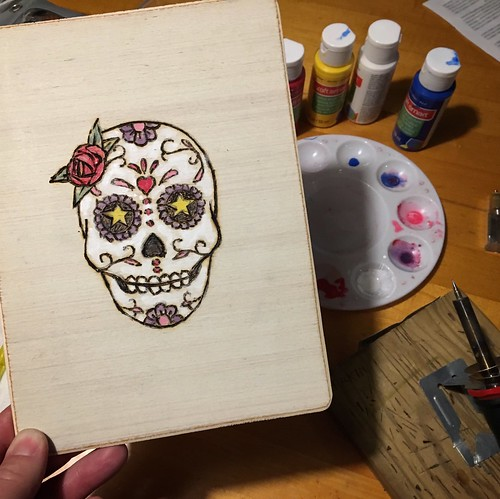 Wood burning a pyrography and acrylic sugar skull.