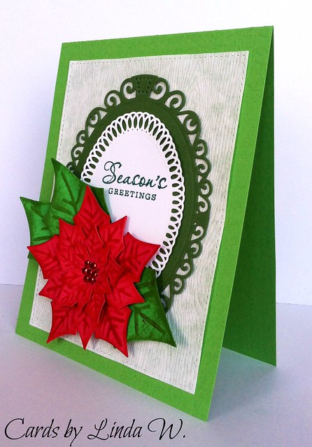 Seasons Greetings poinsettia
