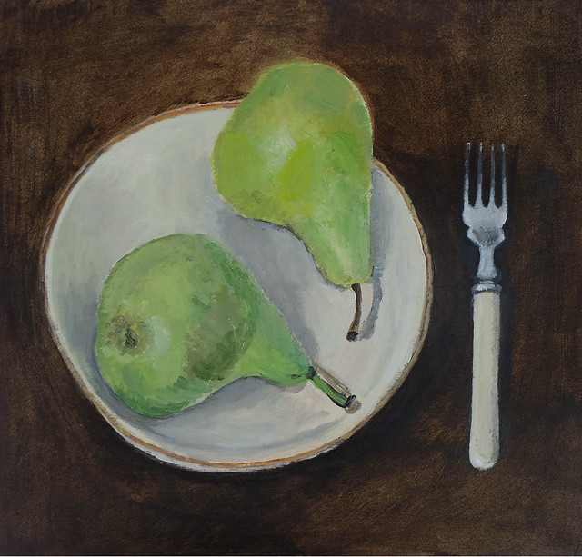 pears in a handmade dish with dessert fork