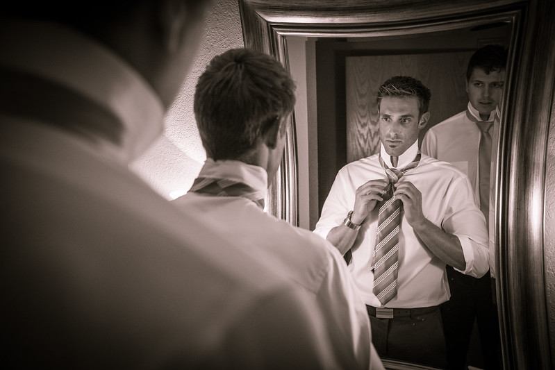 Groom Looks Into the Mirror