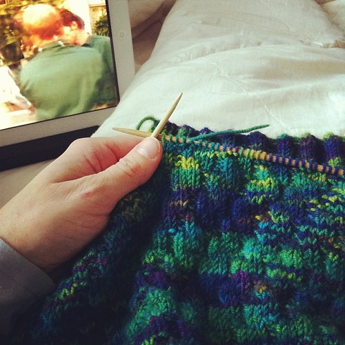 On the couch: working on a knitting project started ages ago while watching what appears to be a cheesy 80's netflix movie #cozyindoors #notgoingoutside | by duckyhouse