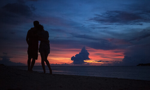 couple enjoying an island sunset