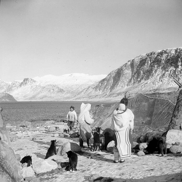 ... A group of Inuit standing outside near their tupiit (tents) showing Pangnirtung Fiord & A group of Inuit standing outside near their tupiit (tentsu2026 | Flickr