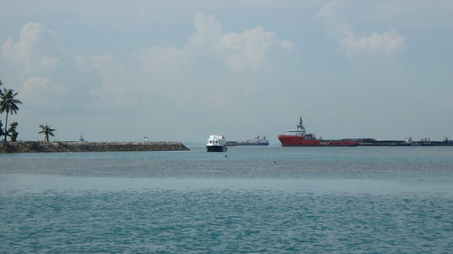 Boat parked very close to reefs at Pulau Hantu