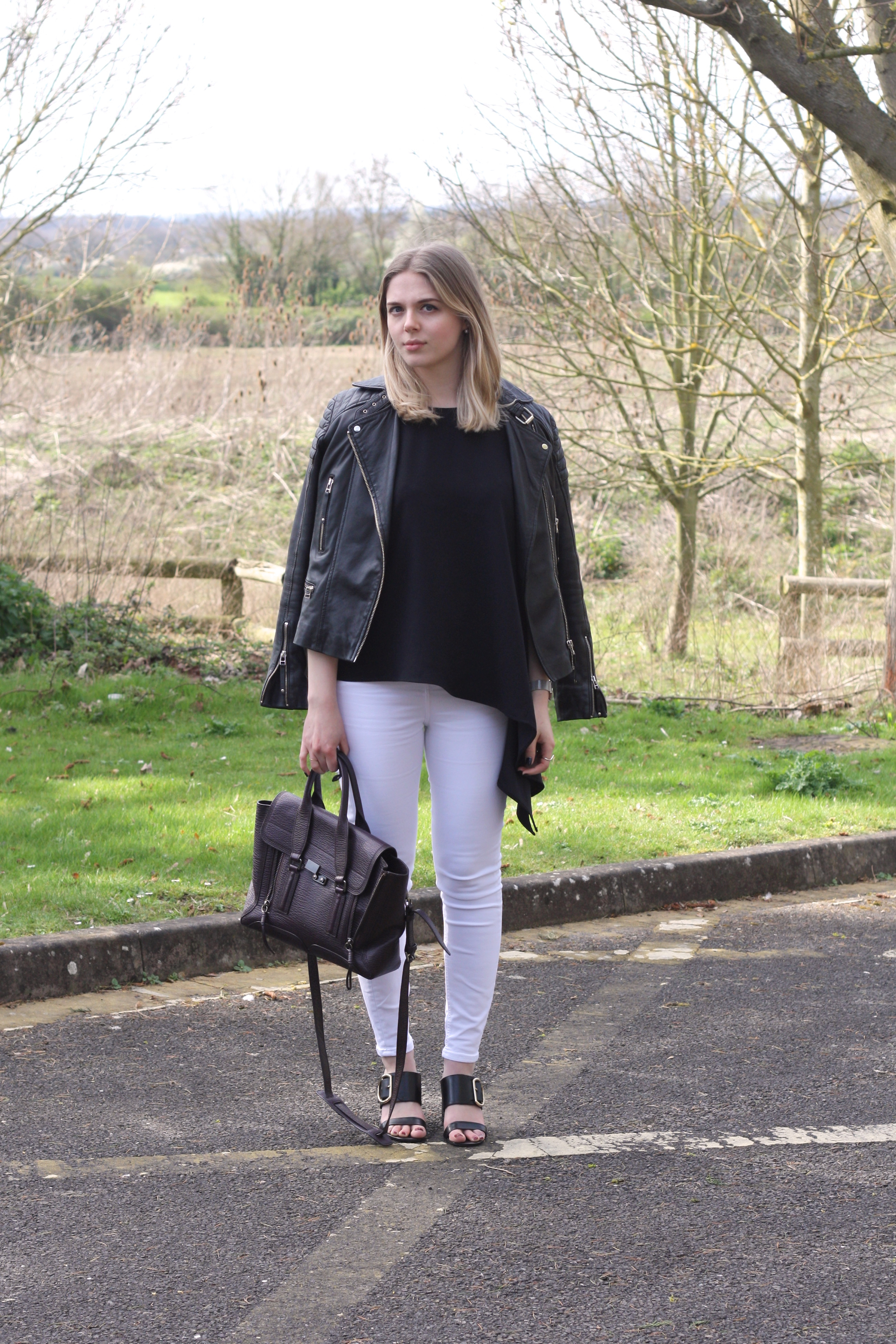 Whistles black leather jacket, Great Plains black asymmetric top and Whistles Fairhope sandals