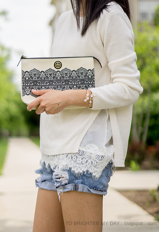 white sweater with lace hem, distressed shorts, wildflower cuff, lace printed clutch