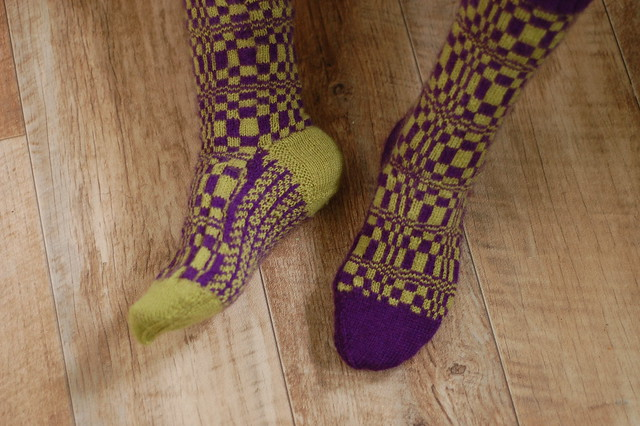 Green and purple patterned socks
