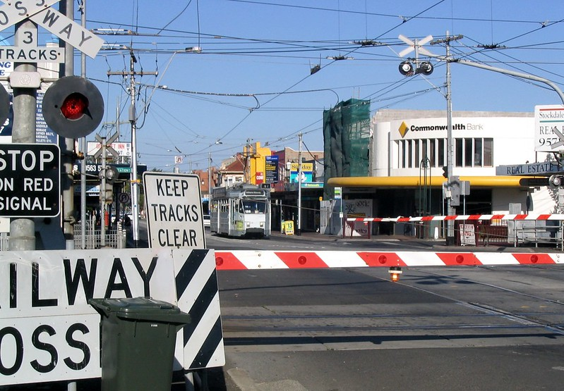 Tram waits for train, Glenhuntly (March 2007)