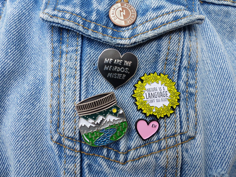 This is a picture of a collection of enamel pins
