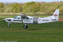 N208AJ - 1998 build Cessna 208B Caravan, arriving on Runway 26R at Barton