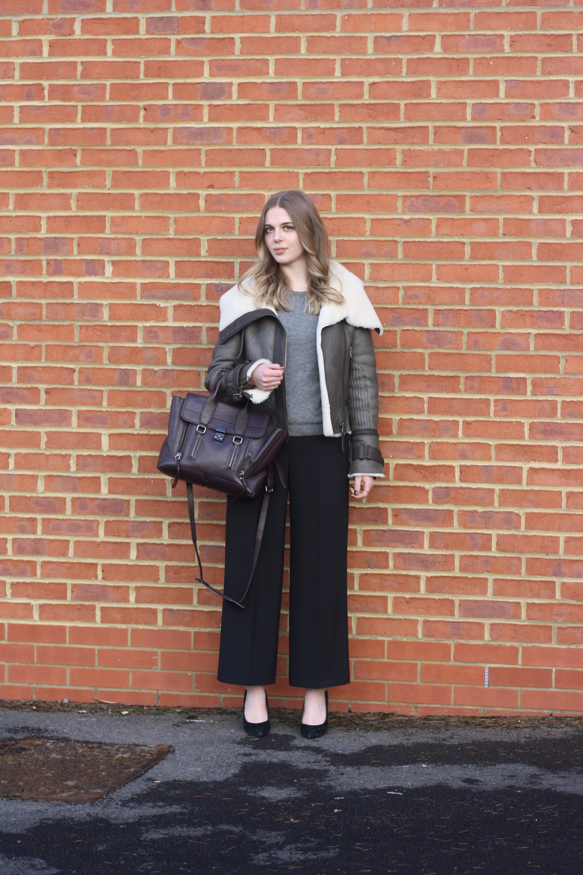 Topshop shearling jacket, HM grey cashmere sweater and Zara black trousers