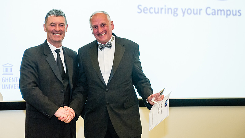 Brian receives his award from Mark Sutton, Chair of AUCSO
