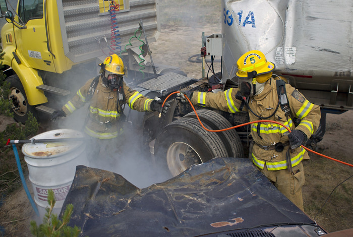 two Emergency responders wearing hazmat suits taking part in an exercise