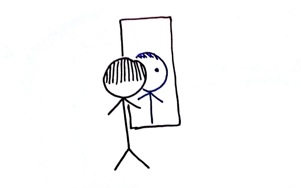 A Stick Person Standing In Front Of A