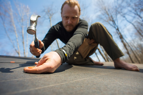 Tyler Affixing Roofing Felt to Grindbygg | by goingslowly