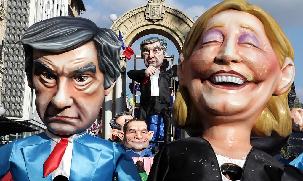 2月11日在法國尼斯嘉年華活動上,帶著總統候選人頭像的人偶。左邊是費雍,右邊是勒朋的人偶。(攝影:Eric Gaillard/Reuters)