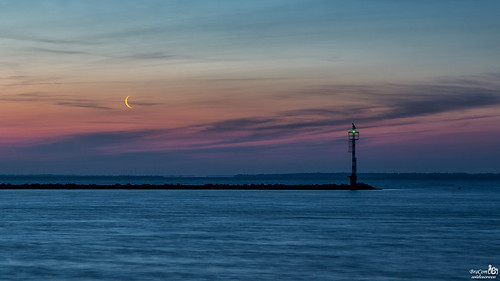 Morning light, moon and beacon