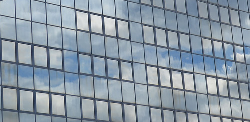 construction-clouds-reflecting-on-glass-and-windows | by ahlea