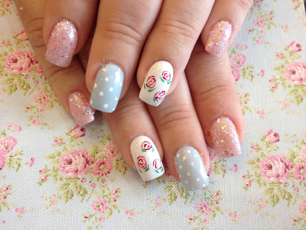 Acrylic nails with baby pink and blue, glitter dust and ro… | Flickr