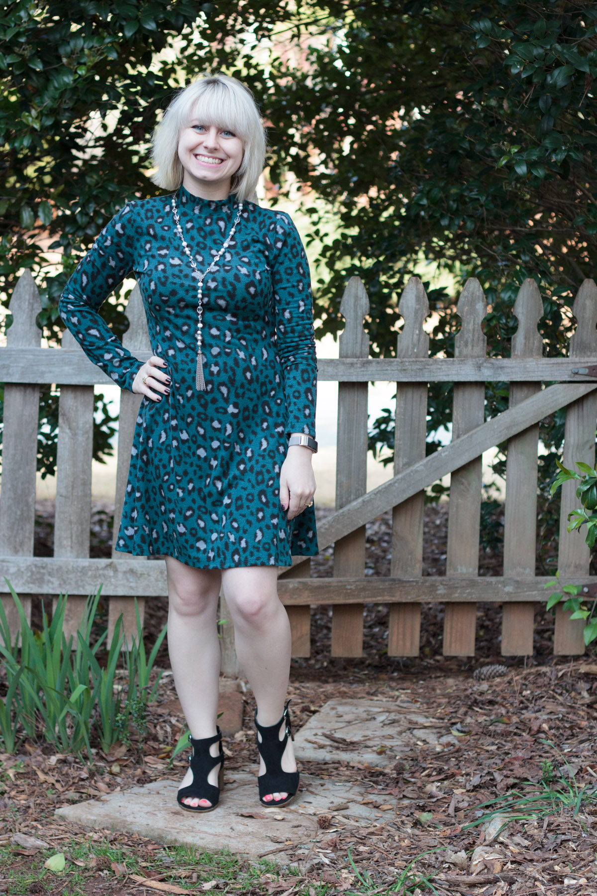 Teal Leopard Mock Turtleneck Dress, Silver Tassel Necklace, Blonde Hair, and Modern Black Block Sandals