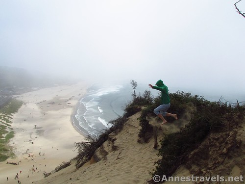 Jumping the upper reaches of the sand dune at Cape Kiwanda, Oregon