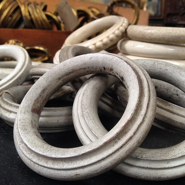 simple well worn antique white wood curtain rings