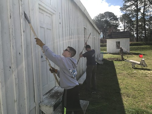 Photo of volunteers working on historic building at Point Lookout State Park
